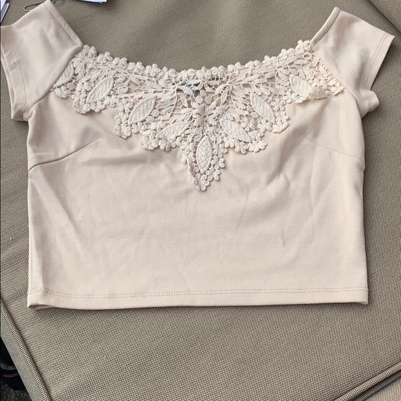 Charlotte Russe Tops - Elegant beige crop top with lace detail